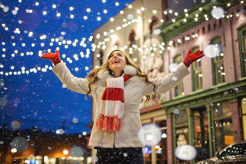 Tulsa Holiday Activities 2020 Woman Catching Snow