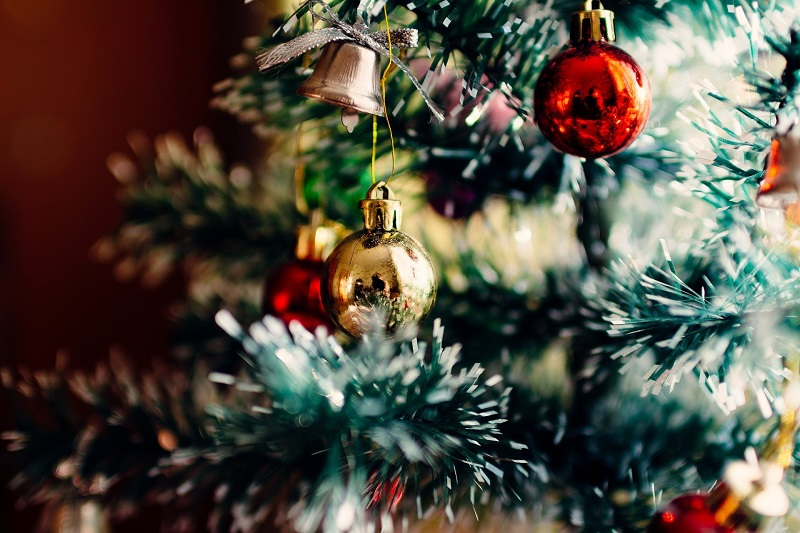 Socially Distanced Holiday Party Ideas a Christmas Tree with Ornaments