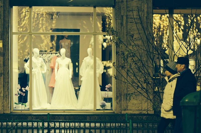 Winter Energy Saving Tips for Businesses Couple Walking By a Winter Window Display