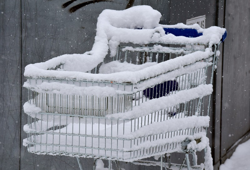 Winter Energy Saving Tips for Businesses Shopping Cart Covered in Snow
