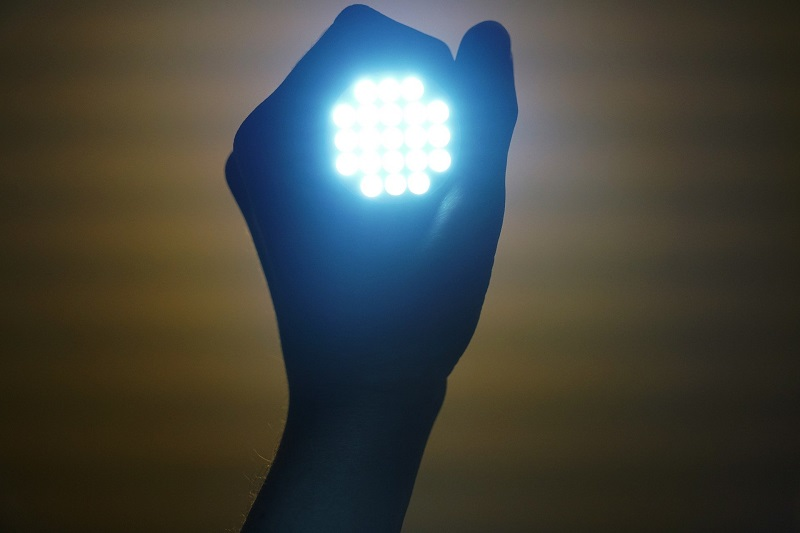 HID vs LED Person Holding an LED Flashlight