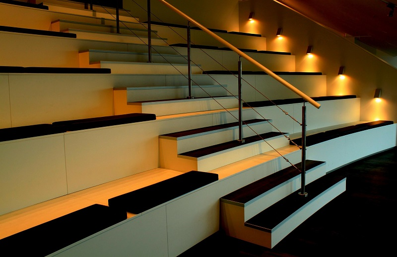 LED Floor Lights Inside of an Auditorium With Lights Pointing at the Floor
