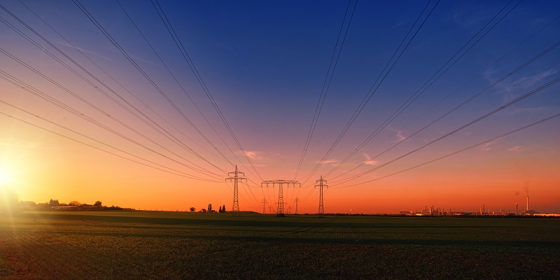 Business Energy Efficiency Ideas Sunsetting Over Powerlines