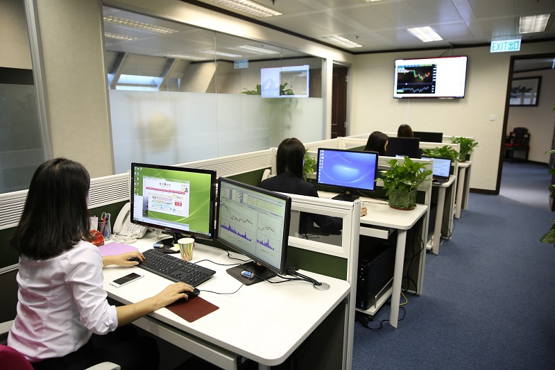 LED Office Lighting Solutions a Row of Cubicles with Women Working in Each One